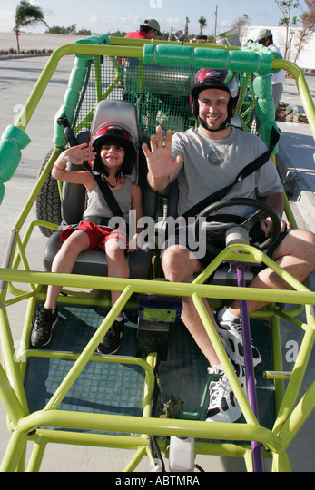 Grand Turk Cockburn Town Cruise Center dune buggy tour vehicle father son - Stock Image