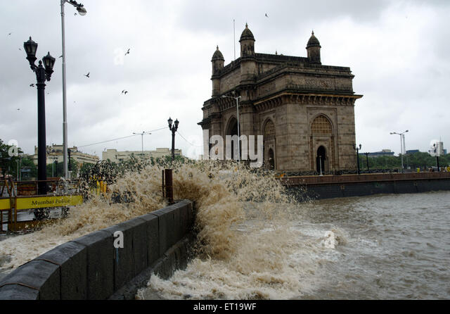 High tide Powerful Crashing Waves Go Crazy during Monsoon at Gateway of India Mumbai Asia - Stock Image