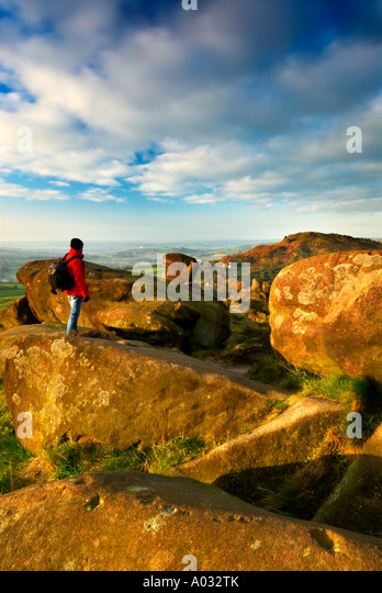 Walker Standing By Ramshaw Rock Looking Towards Hen Cloud At The Roaches Staffordshire UK - Stock Image