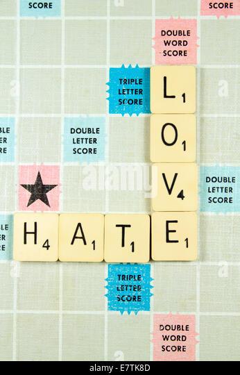 Love Hate on Scrabble Board - Stock Image