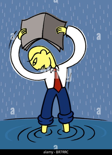 A businessman stranded in a flood during a heavy rain - Stock Image