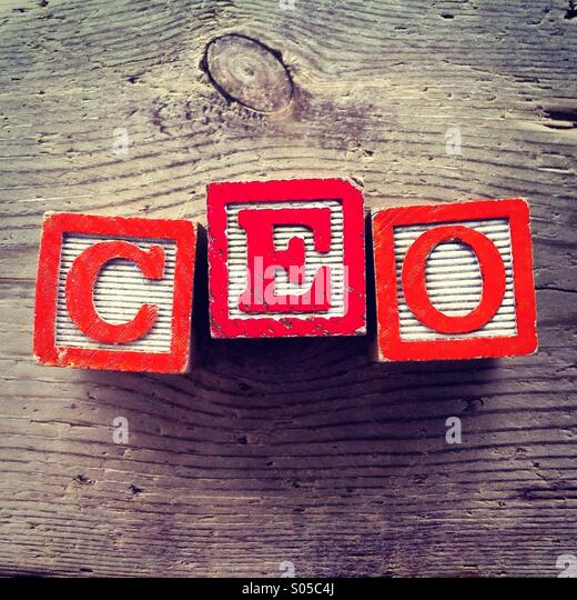 It's a photo of wood blocks toy with letters that form the acronym word CEO - Stock Image
