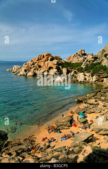 Italy Sardinia Capo Testa Cala Spinosa sand beach with cristal clear water surrounded by bizarre rocks - Stock Image