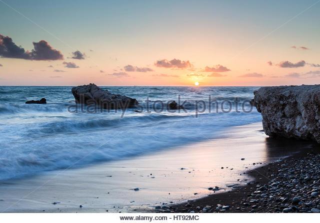 Sunset on Mediterranean Sea by Petra tou Romiou, Paphos, Cyprus - Stock Image
