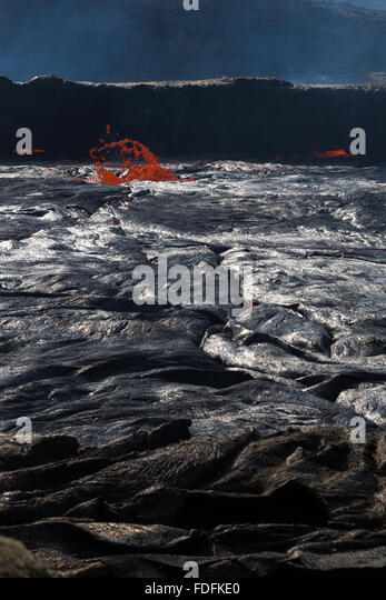 Early morning activity at the unusually high lava lake at Erta Ale - Stock Image