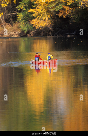 USA IDAHO BOISE Couple canoeing in reflecting autumn colors on the Boise River MR - Stock Image