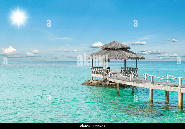 Summer, Travel, Vacation and Holiday concept - Wooden pier in Phuket, Thailand - Stock Image
