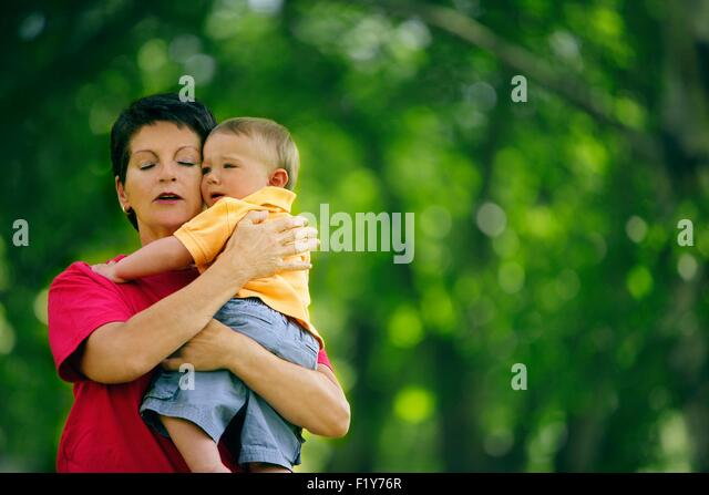 Toddler Is Comforted While Crying - Stock Image