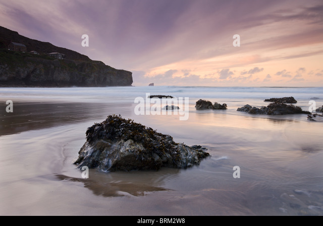 Sunset from the sandy shores of Trevaunance Cove, St Agnes, Cornwall, England. Summer (September) 2009. - Stock Image
