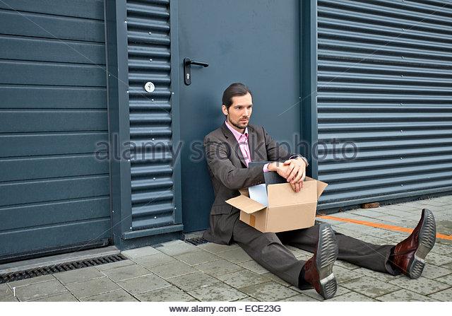 Man depressed homeless unemployed penniless broke - Stock Image