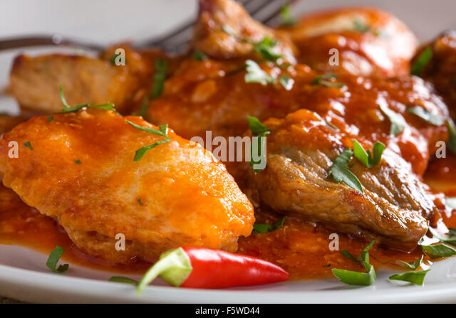Classic Hungarian goulash with dumplings, delicious heavy food, homemade dumplings - Stock-Bilder