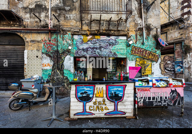 Street bar in the graffiti covered neighborhood of Palermo, Sicily. - Stock Image