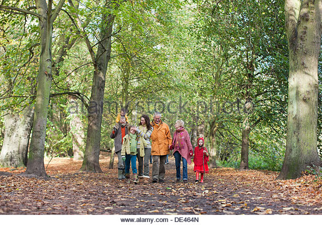 Extended family walking outdoors in autumn - Stock Image