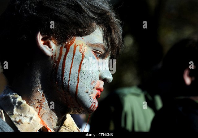 Hundreds of people taking part in the annual Beach of the Dead Zombie walk in Brighton 2012 - Stock Image