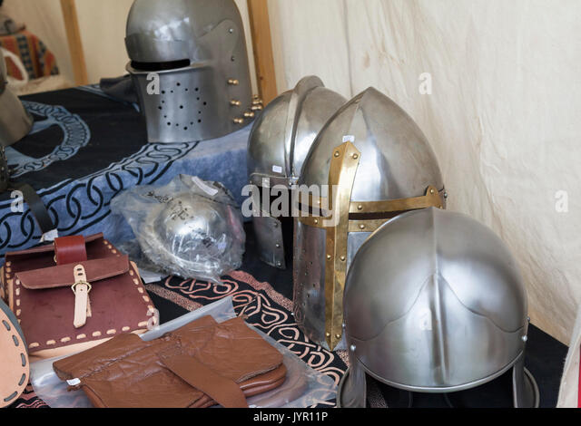 A display of replica medieval helmets for sale - Stock Image