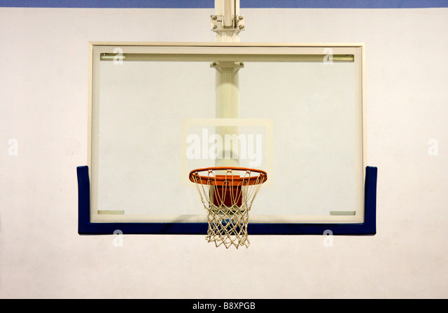 Indoor Basketball Hoop in School Gymnasium - Stock Image