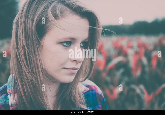 Sad depressed woman concept - Stock Image