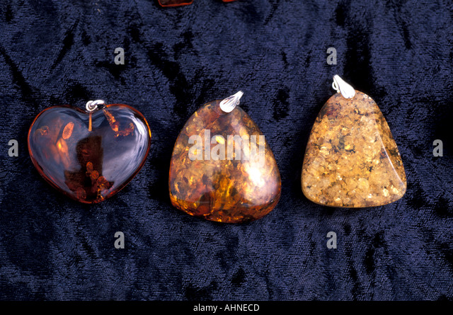 Amber Jewelry three stones heart shape pyramids Moscow Russia Shopping typical souvenirs - Stock Image