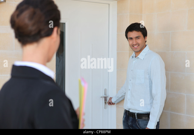 female realtor and client indoors - Stock Image