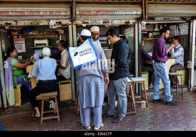 Mumbai India Indian Asian Tardeo Jehangir Boman Behram Road sidewalk vendor stall computer services scanning email - Stock Image