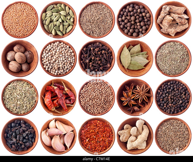 Wooden bowls full of different spices isolated on white background - Stock Image