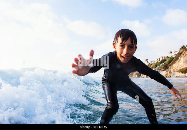 Young boy surfing, Encinitas, California, USA - Stock Image