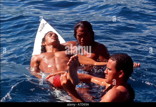 RECREATION OF SHARK ATTACK BY LIFE GUARDS HAWAII - Stock Image