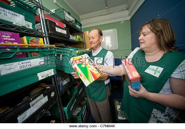 Volunteers working in a Foodbank in Kings Lynn, Norfolk - Stock Image
