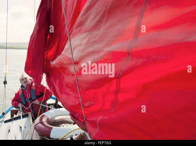 Senior man on sailing boat - Stock Image
