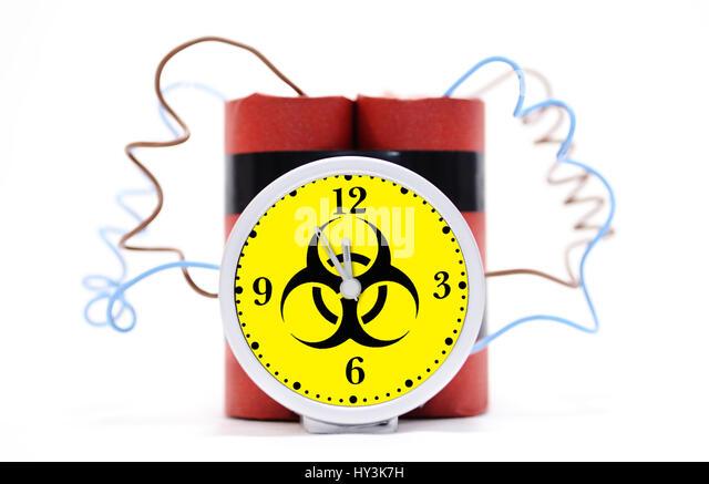 Time bomb with biology danger sign, Zeitbombe mit Biogefährdungszeichen - Stock Image