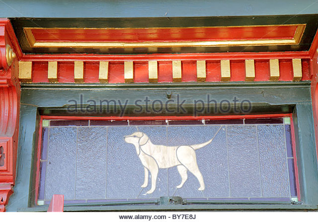 Baltimore Maryland Fells Point historic district neighborhood business bar door stained glass yellow lab Kooper's - Stock Image