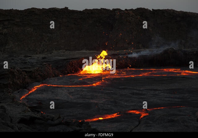 A lava bubble burst at the edge of the crater of Erta Ale volcano in Ethiopia - Stock Image