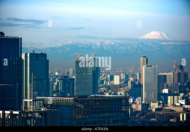 Mount Fuji viewed across Tokyo from the Central Station area - Stock Image