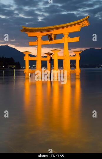 The floating Miyajima torii gate of Itsukushima Shrine at dusk, UNESCO, Miyajima Island, Western Honshu, Japan, - Stock Image