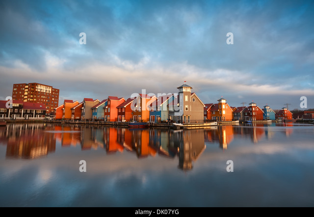 colorful buildings on water during sunrise, Reitdiephaven, Groningen, Netherlands - Stock Image