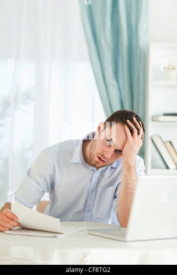Businessman got bad news via mail - Stock Image