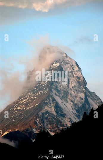 Switzerland Matterhorn peak clear day mountain swiss alps overlooks town of Zermatt iconic symbol emblem  image - Stock Image