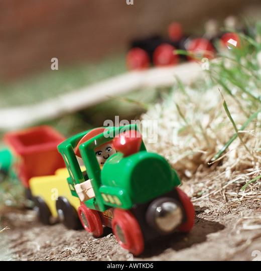Child's toy train sitting on ground - Stock-Bilder