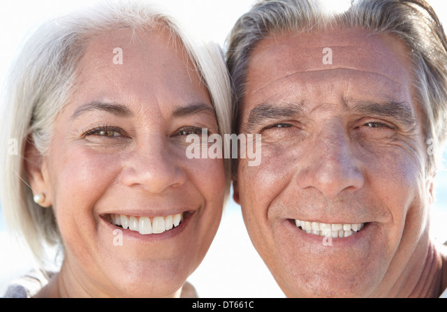 Close up portrait of happy couple - Stock Image