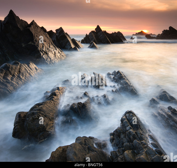Dramatic coastal scenery at sunset, Hartland Quay, North Devon, England. Spring (April) 2010. - Stock Image