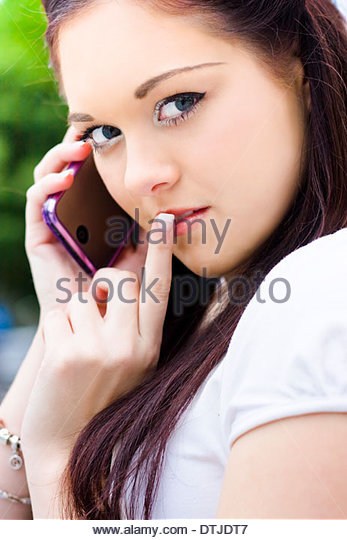 Mysterious Business Woman Gesturing A Hush For Quiet Silence While Taking A Private And Personal Phone Call In A - Stock Image