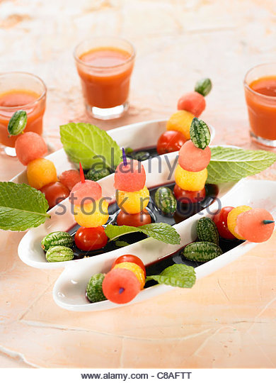 Watermelon,melon,cherry tomato and mint brochettes - Stock Image