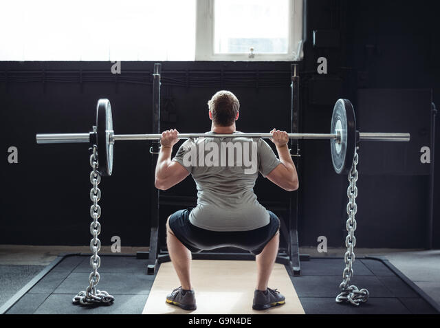 Healthy and fit male weightlifting for exercise. - Stock Image