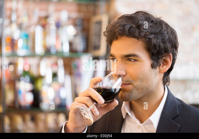 Male cheerful coffee restaurant alcohol - Stock Image