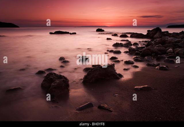 Dusk scene from Kalamitsi beach near Kardamili in the Peloponnese - Stock-Bilder