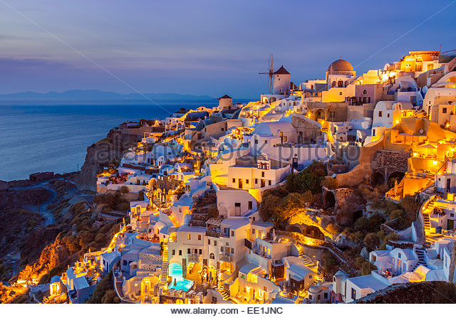 Windmill and traditional houses after sunset, Oia, Santorini (Thira), Cyclades Islands, Greek Islands, Greece, Europe - Stock-Bilder