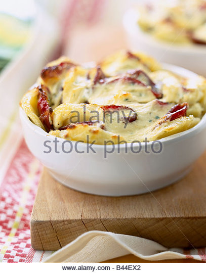 Potato and  smoked ham gratin - Stock-Bilder