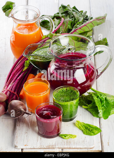 Healthy vegetable smoothie and juice. Selective focus - Stock Image