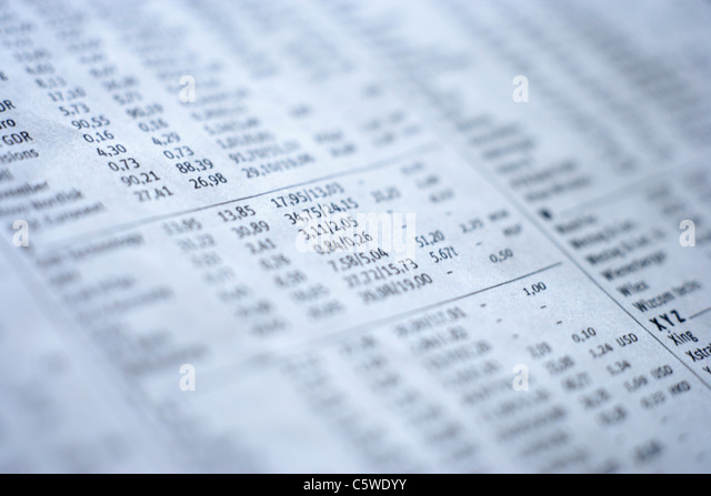 Extreme close up of stock exchange financial figures in newspaper - Stock Image