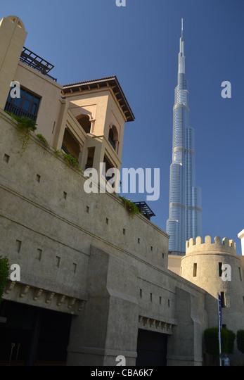 World's tallest building Burj Khalifa and old buildings, Dubai, United Arab Emirates - Stock Image